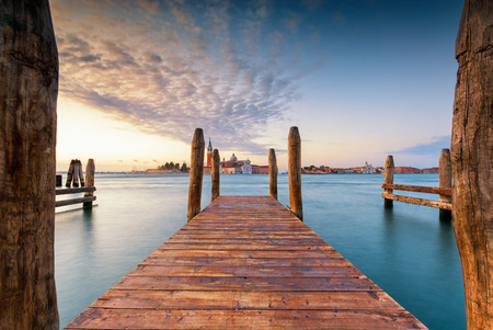 Long exposure view of the San Giorgio church across jettys of the Grand Canal, Venice, Italy
