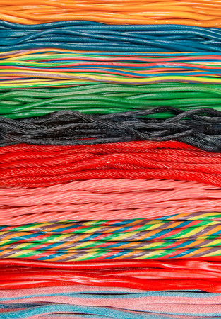 liquorice: Long row of colorful rainbow soft licorice candy Stock Photo