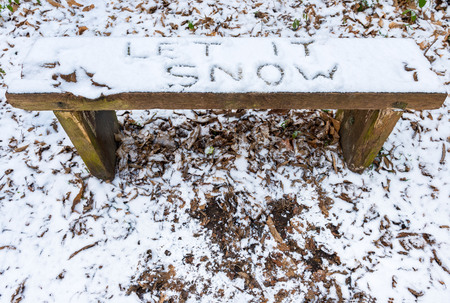 Let it Snow lyricchristmas message written in snow on a bench