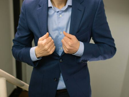 Business man on stairway wearing blue blazer jacket ready for appointment