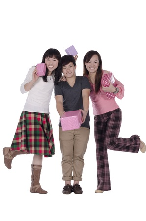 Pretty girls holding the box of gift on white background photo