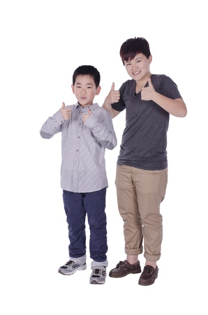 Two teenagers gives the thumbs up with white background
