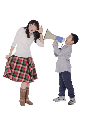 Child yell at mother with megaphone over white background