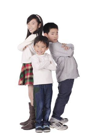 Three cute children posed over white background photo