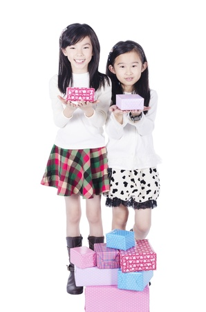 Two pretty girls get gifts on white background Stock Photo
