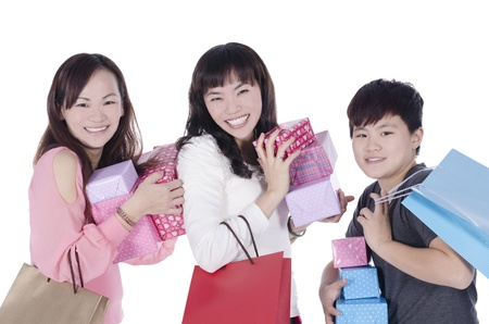Three pretty girls smiling holding shopping bag and gifts  on white background photo