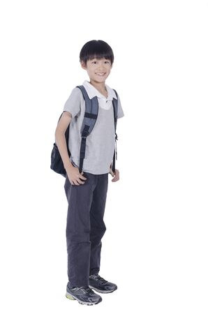 Happy smart boy ready for school over white background Stock Photo