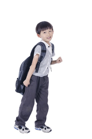 Happy smart boy expect for school over white background