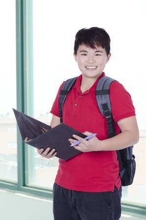 Young pretty Asian student open note and smile