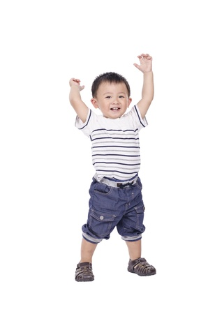 Little boy stand and raise hands up photo
