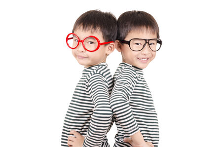 Two brother  smiling on white background photo