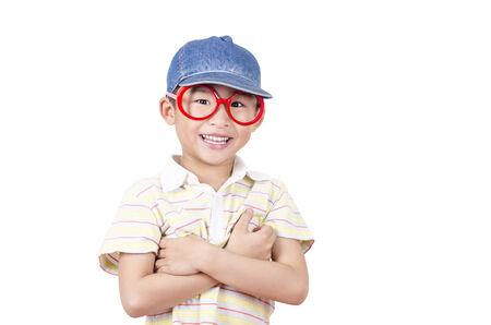 Cute little boy arm folded on white background Stock Photo