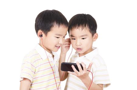 Cute children listen to music Stock Photo