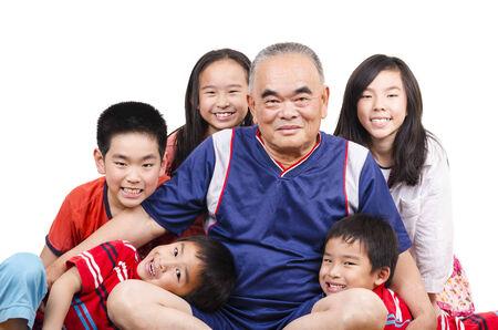 Happy grandfather and grandchildren joyful moment Stock Photo