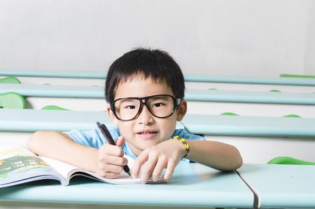 Smart student writing his work photo