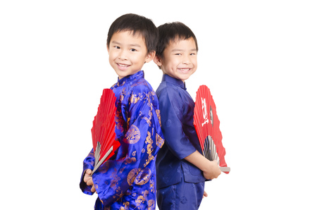Twin boys performing chinese kung fu