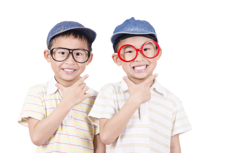 Cute twin  smiling on the white background Stock Photo