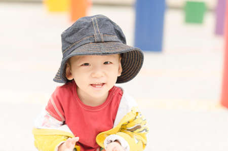 A smiling cute kid  in the park