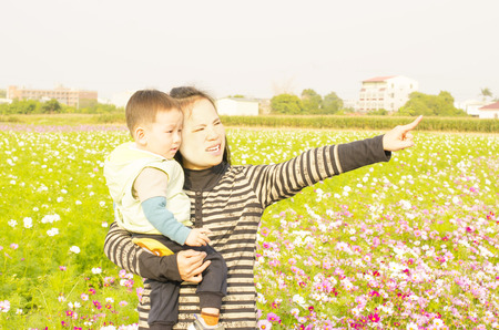 Mother and son in flower yard