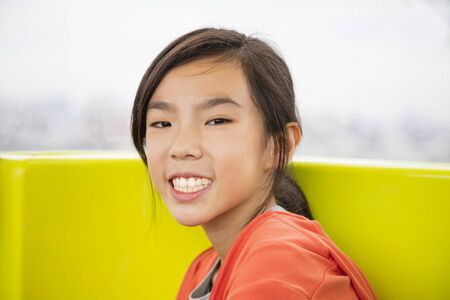 Beauty girl smiling and to look ahead Stock Photo