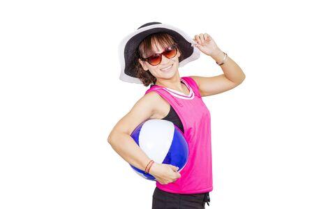 Beautiful young woman wearing hat and sunglass