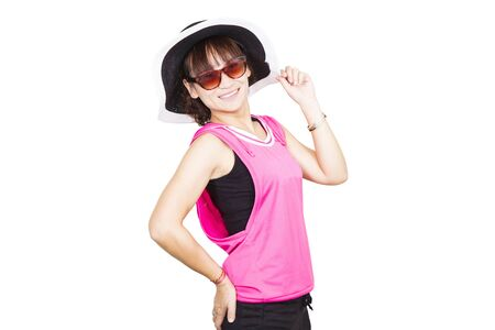 Beautiful young woman wearing hat and sunglasses