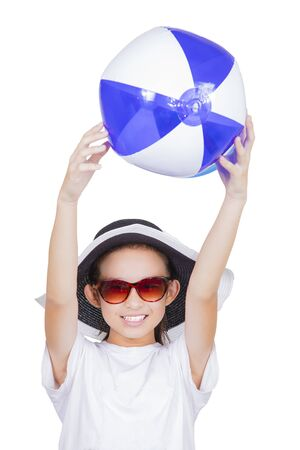Girl catching beach ball Stock Photo