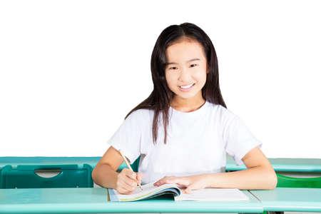 Pretty female student writing homework
