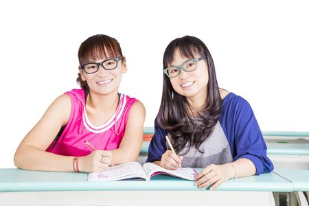 Two girls learning at classroom Stock Photo