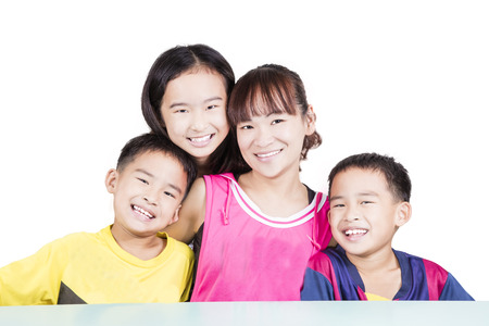 Young family smiling on white background Stock Photo