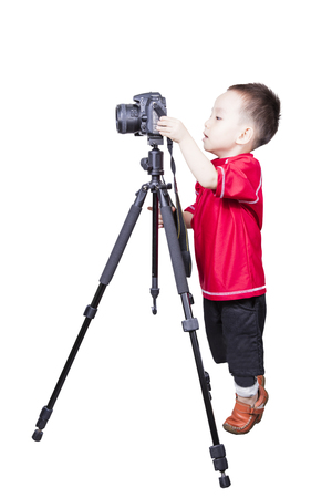 Smart kid playing camera isolated background