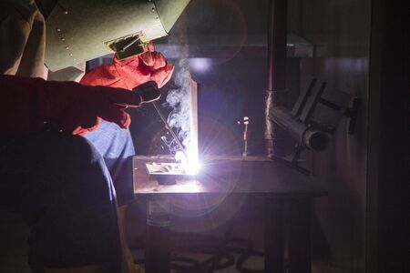 Worker use electric weld steel Stock Photo