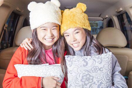 Beauty girls smiling in car