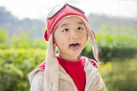 Cute smart kid wearing flight cap