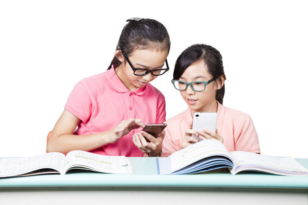 Girl students using mobile phone