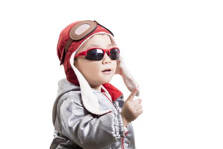 Happy kid helmet pilot playing
