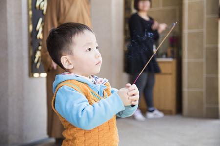 Smart boy praying for buddha
