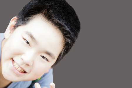 Smart boy smiling  on blackground