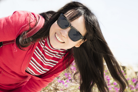 Beauty girl smiling and wearing sunglasses Stock Photo
