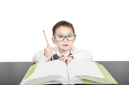 teen boy: School child boy in glasses think in Classroom, Kid Primary Students Reading Book, Excellent Learn Lesson and Dream, Education Concept