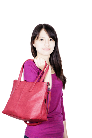 Fashion girl holding a red hand bag