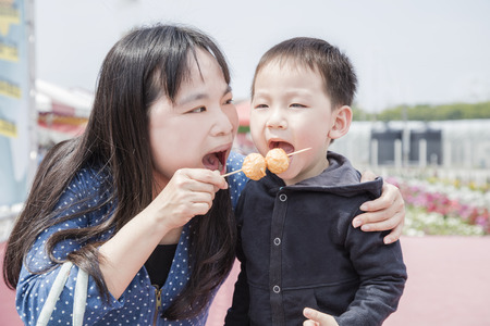 Mother and son having fun eating dessert Stock Photo