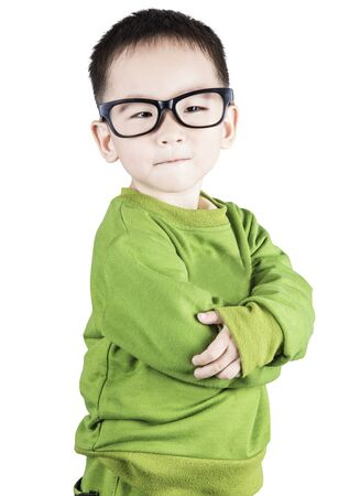 Smiling boy looking at camera with joy and confidence, isolated on white background.