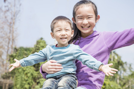 Two young children pose together smiling. Stock Photo