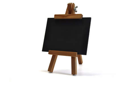 Small blackboard on easel for your text � might be a restaurant�s menu, announcing a special offer or opening of a new store, a back to school announcement or whatever you want to communicate. photo
