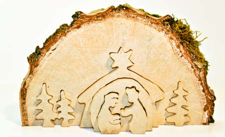 Cut out of  birch tree slice showing christmas nativity: Mary, Joseph, baby Jesus