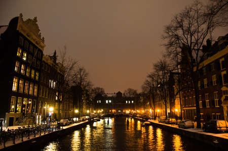 Snowy Amsterdam At Night photo