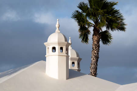 turreted: Typical Lanzarote Chimneys Stock Photo