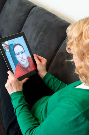 online chat: Video Telephony on Digital Tablet PC Stock Photo