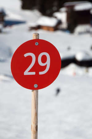 Number 29 on red sign next to ski slope in Montafon, Austria photo